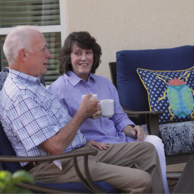 An older couple shares coffee outside